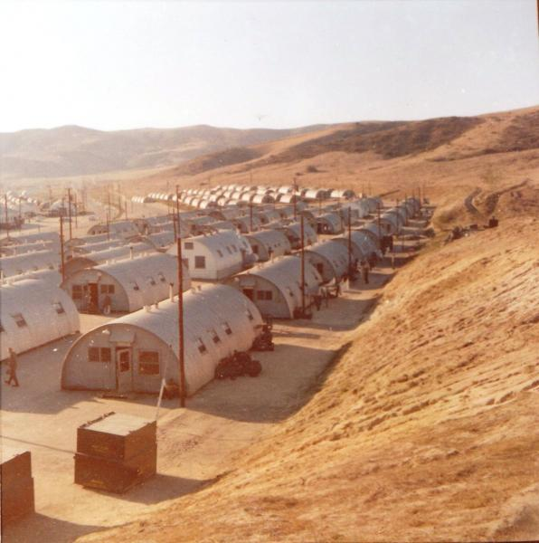 Original caption from Lady Leatherneck Forum:  This is Camp San Onofre part of Camp Pendleton California up against the Horno Ridge a part of the Sierra Nevada Mountains on a weekend afternoon in January 1961. The dark areas in the shade of the Quonset huts are groups of marines relaxing and swapping sea stories.